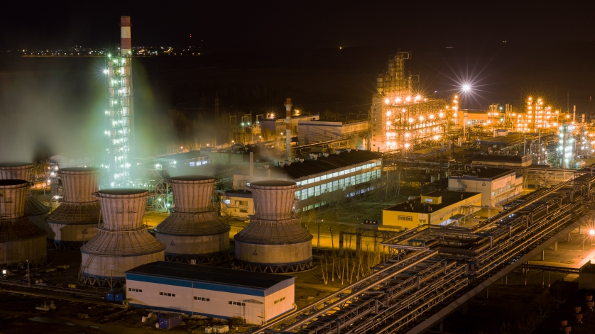 panorama of large chemical plant at night with light