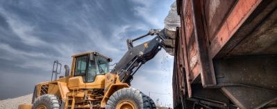 Wheel loader excavator with backhoe unloading clay