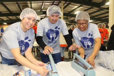 WIKA employees pack meals