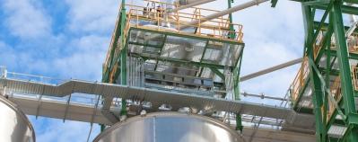 Polyethylene storage tanks at a chemical plant.
