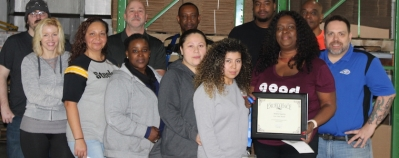 Core values winner surrounded by her coworkers in the Pressure Gauge Division